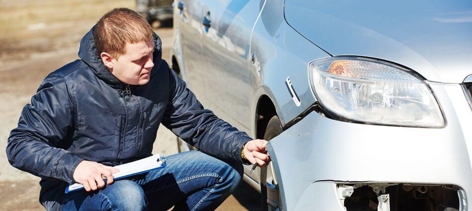 man inspecting car crash accident fender bender